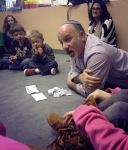 Rabbi Paul Kipnes with little kids
